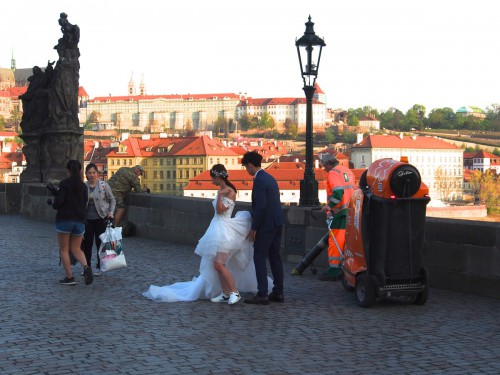 Charles Bridge: A photo with street-cleaning process in the background